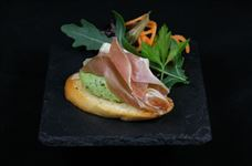 Bruschetta with broadbean and prosciutto